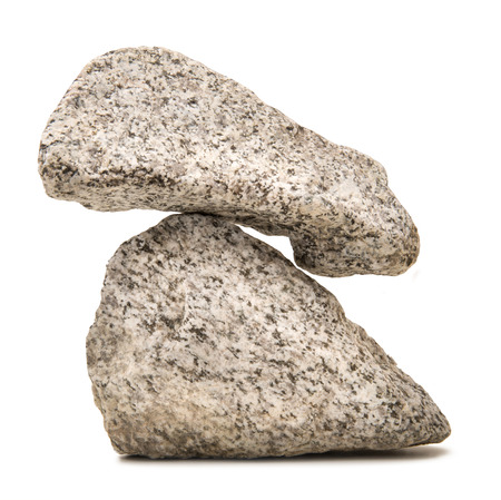 two balanced stones on a white background Stock Photo
