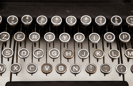 classical mechanics: Particular of old typewriter on white background