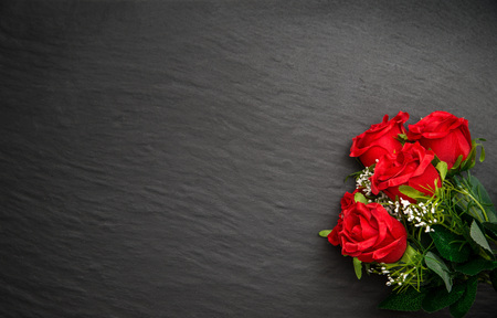 valentine background: black stone background with colored flowers Stock Photo