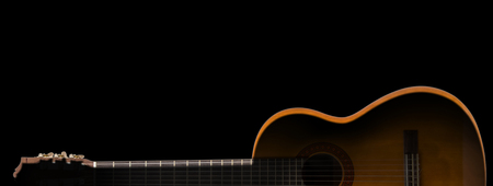 backlit keyboard: silhouette of classic guitar on black background