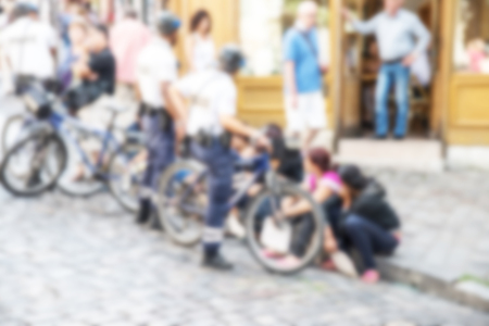 City scene background with unrecognizable people and blur effect