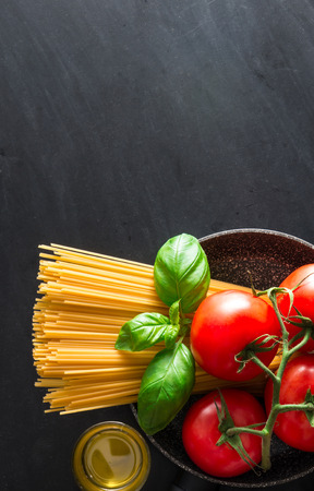 dark texture of Italian pasta with various ingredients Stock Photo