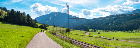 mountain landscape with railroad and bike path Stock Photo