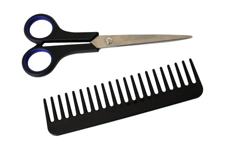 Scissors and comb isolated on white background Stock Photo - 8834474