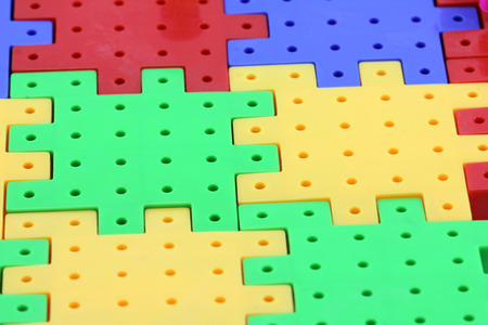 Colorful plastic puzzle Stock Photo