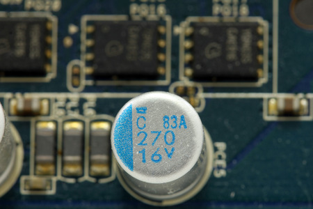 Close up of capacitor on motherboard Stock Photo
