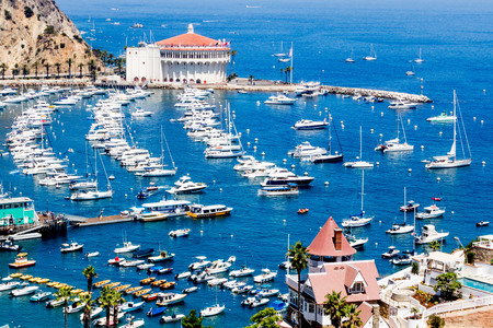 Overhead bay view of Avalon harbor with casino, pleasure pier, sailboats and yachts on Santa Catalina island vacation in California