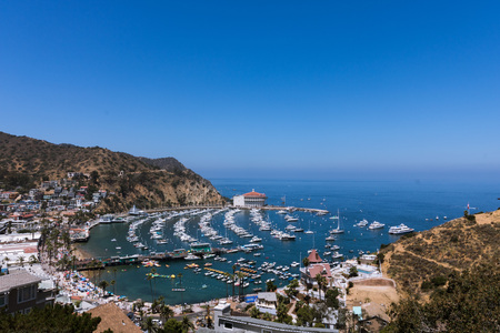 Overhead wide angle bay view of Avalon harbor with casino, pleasure pier, sailboats and yachts on Santa Catalina island vacation in California, USA luxury leisure vacation Stok Fotoğraf