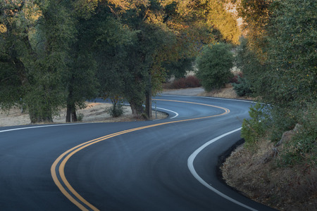 Two lane, winding paved country road in southern califonia