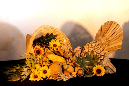 Thanksgiving cornucopia centerpiece with sunflowers and turkey celebrating fall autumn harvest holiday, seasonal symbols of plenty and abundance Standard-Bild