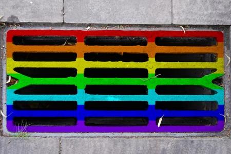 iridescent: Storm drain in iridescent colors Stock Photo