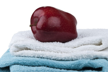 Fresh apple on two towels isolated on white background photo