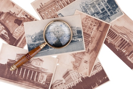 Pile of old cards with a magnifier isolated on white background Stock Photo - 12756653
