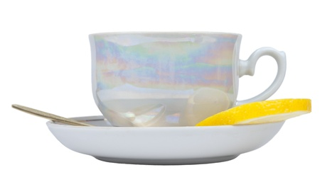 Cup of tea and sauser with lemon and spoon Stock Photo - 12905919