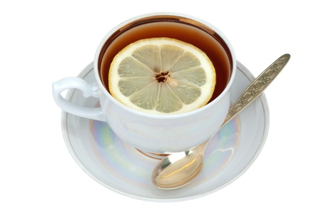 Cup of tea and sauser with lemon and spoon  photo