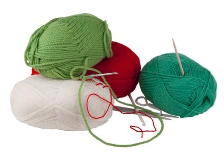 Knitting tools isolated on white background photo