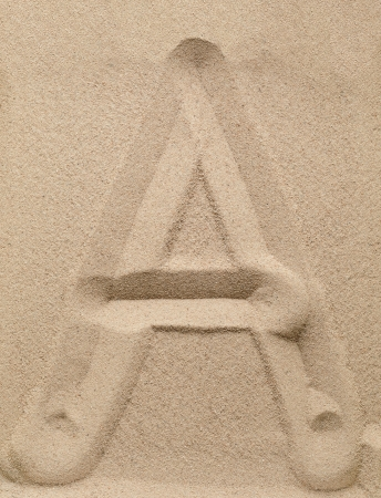 alphabetic character: Letter A of the alphabet writing on the sand