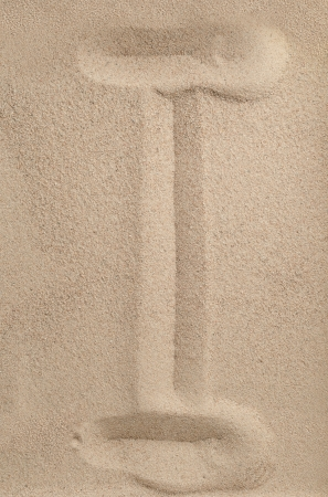 Letter I of the alphabet writing on the sand photo