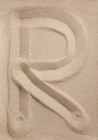 Letter R of the alphabet writing on the sand Stock Photo - 15837061