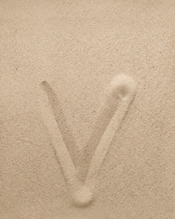 Letter v of the alphabet writing on the sand photo