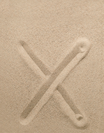 consonant: Letter x of the alphabet writing on the sand