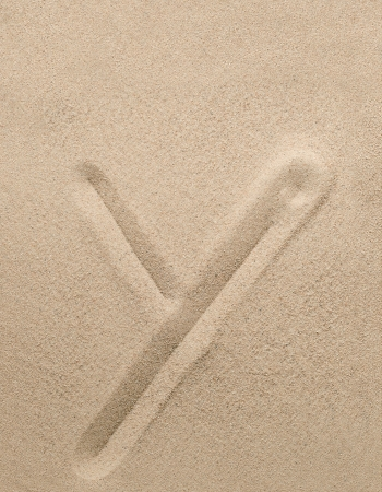Letter y of the alphabet writing on the sand photo