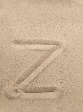Letter z of the alphabet writing on the sand photo