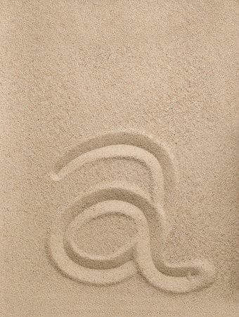 Letter a of the alphabet writing on the sand Stock Photo - 16851062