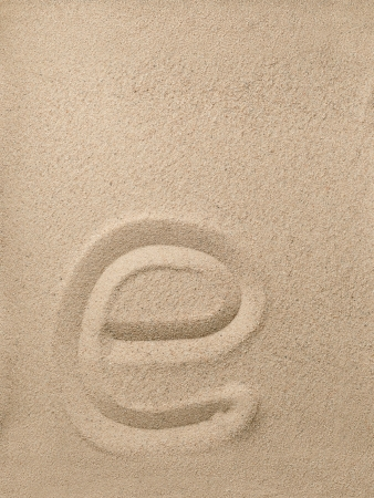 Letter e of the alphabet writing on the sand Stock Photo - 16851061