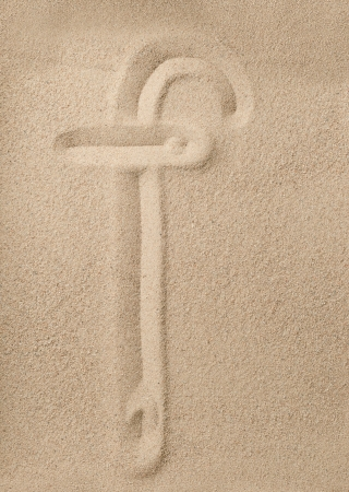 Letter f of the alphabet writing on the sand photo