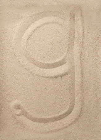 Letter g of the alphabet writing on the sand photo