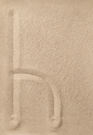 Letter h of the alphabet writing on the sand photo