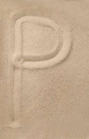 Letter p of the alphabet writing on the sand photo