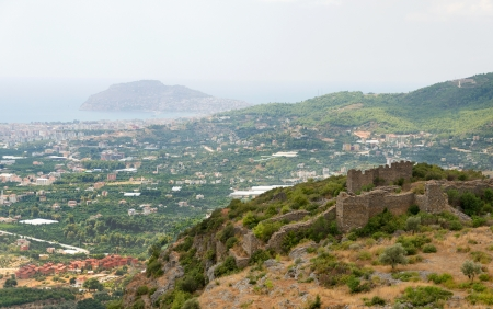 The ruins of the castle on the background of Alanya Stock Photo - 16850981