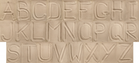 alphabet from sand  Capital letters  photo