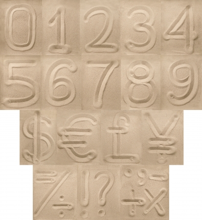 Digits, punctuation and currency symbols from sand Stock Photo - 16912661