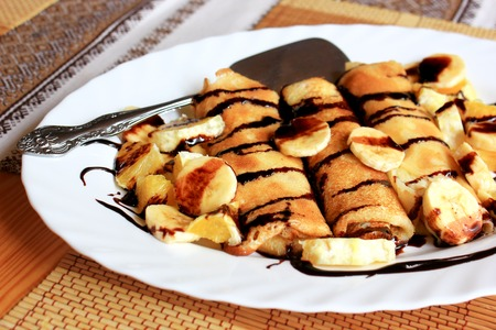 drenched: Pancakes stuffed with semolina, bananas and oranges drenched with dark chocolate
