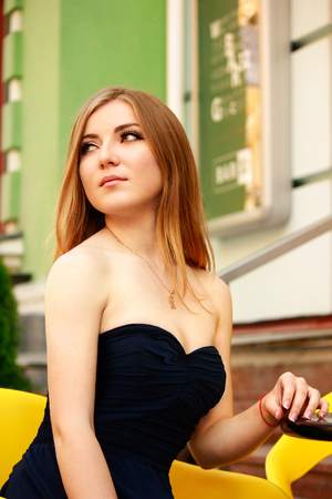 prom dress: beautiful blonde woman in prom dress in the city