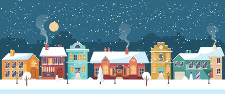 Snowy night in cozy town city panorama. Winter village landscape Reklamní fotografie - 69506609
