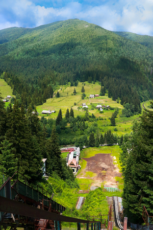 summer view of Carpathian Mountains landscapevillage Vorohta Ukraine. Green forests, hills, grassy meadows and blue sky Stock Photo