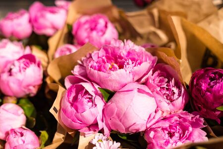 Freshly picked bouquet of peony flowers on display at the farmers market. Pink peonies for sale Stock Photo