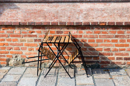 Outdoor street cafe tables ready for service. Cafe or Restaurant Decorate with Red Brick Wall