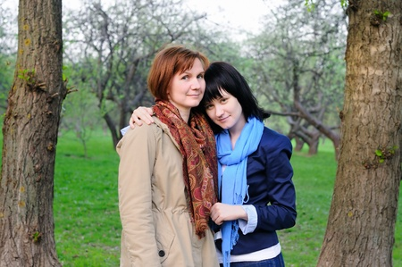 Attractive mother and her daughter in garden  Stock Photo