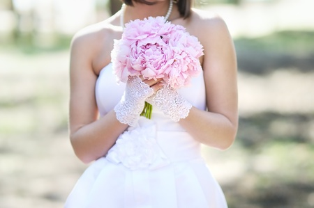 Woman holding pink wedding flowers bouquet