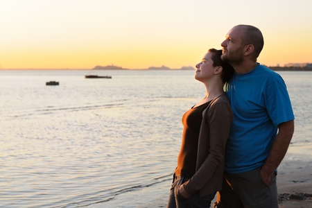 bald head island: Portrait of bald young woman and bald man at sunset