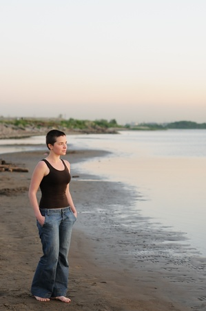 Portrait of bald young woman at sunset  Stock Photo