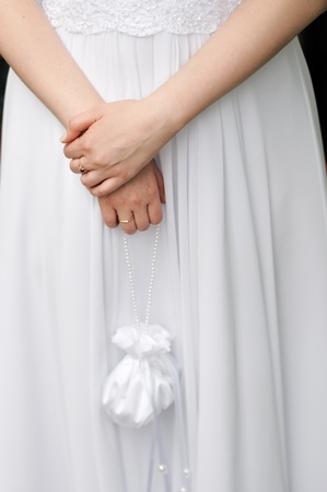 Bride holding small wedding bag with pearls  photo