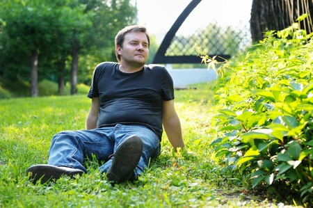 potbellied: Man sitting on the grass