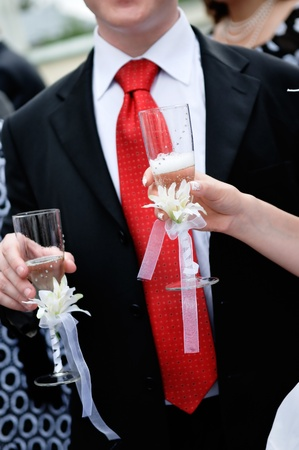 Bride and groom are holding champagne glasses Stock Photo - 9979071