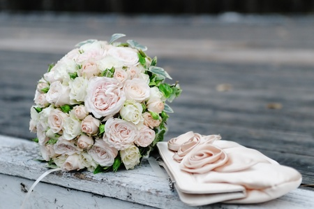 Beautiful pink wedding flowers bouquet and bride handbag Stock Photo